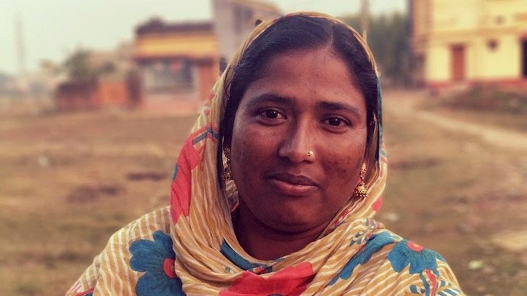 Regina Bibi, whose husband drives an e-rickshaw, hopes that her children don't have to take to the same profession.