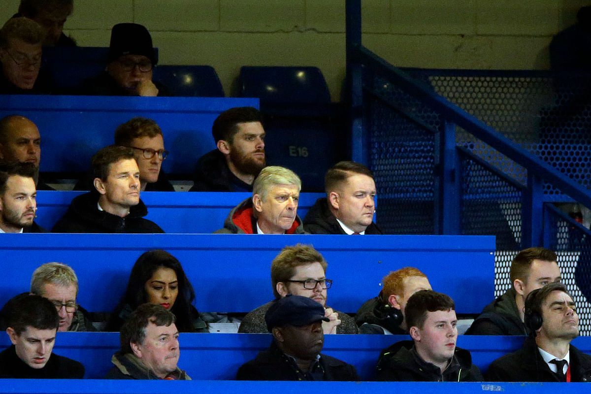 Arsenal manager Arsene Wenger looks out from the press box during the English League Cup semifinal at Stamford Bridge stadium.
