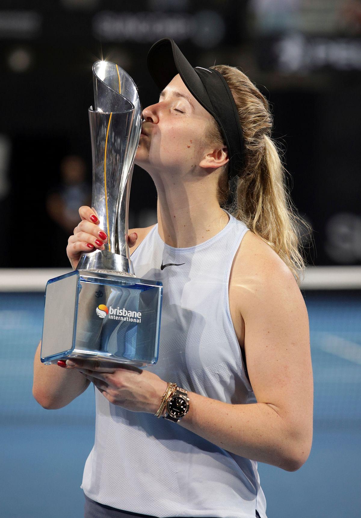 Elina Svitolina of Ukraine holds the winners trophy after winning her finals match against Aliaksandra Sasnovich of Belarus 6-2, 6-1 during the Brisbane International tennis tournament in Brisbane, Australia, Saturday, Jan. 6, 2018.<a></a>