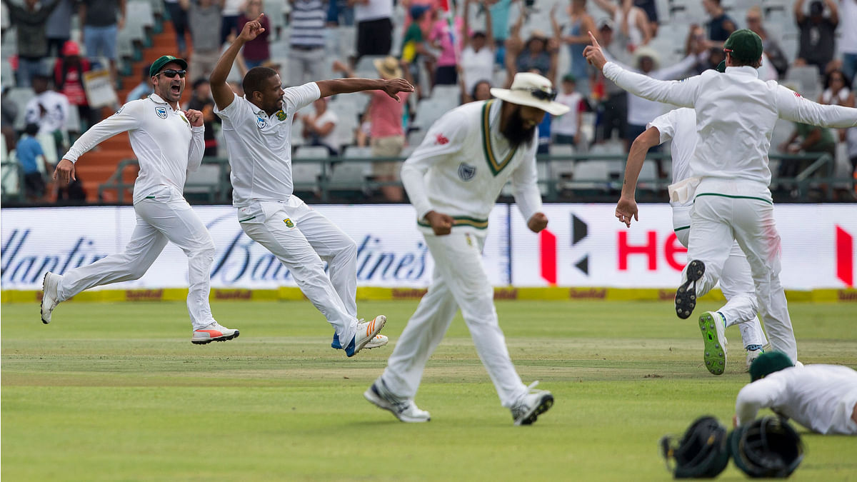 Jubilant South African players celebrate after their victory against India in Cape Town.