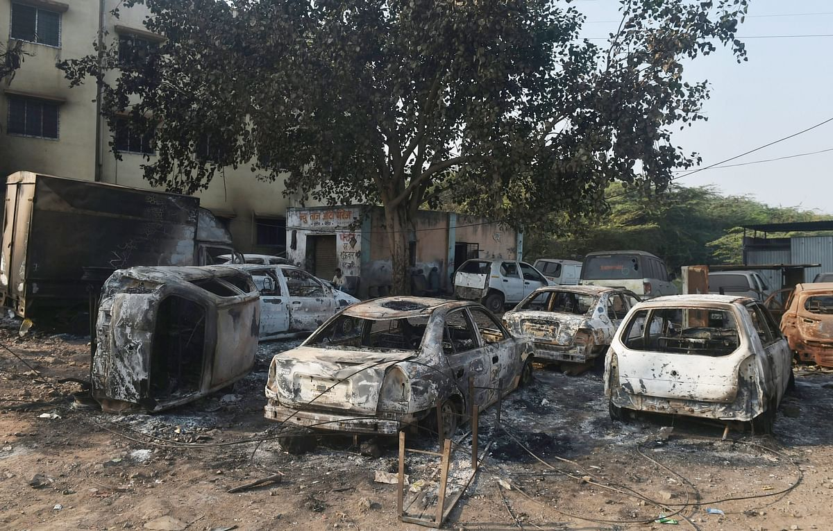 Charred vehicles following the violence during celebrations of 200th anniversary of the Battle of Bhima Koregaon, near Pune on Tuesday.