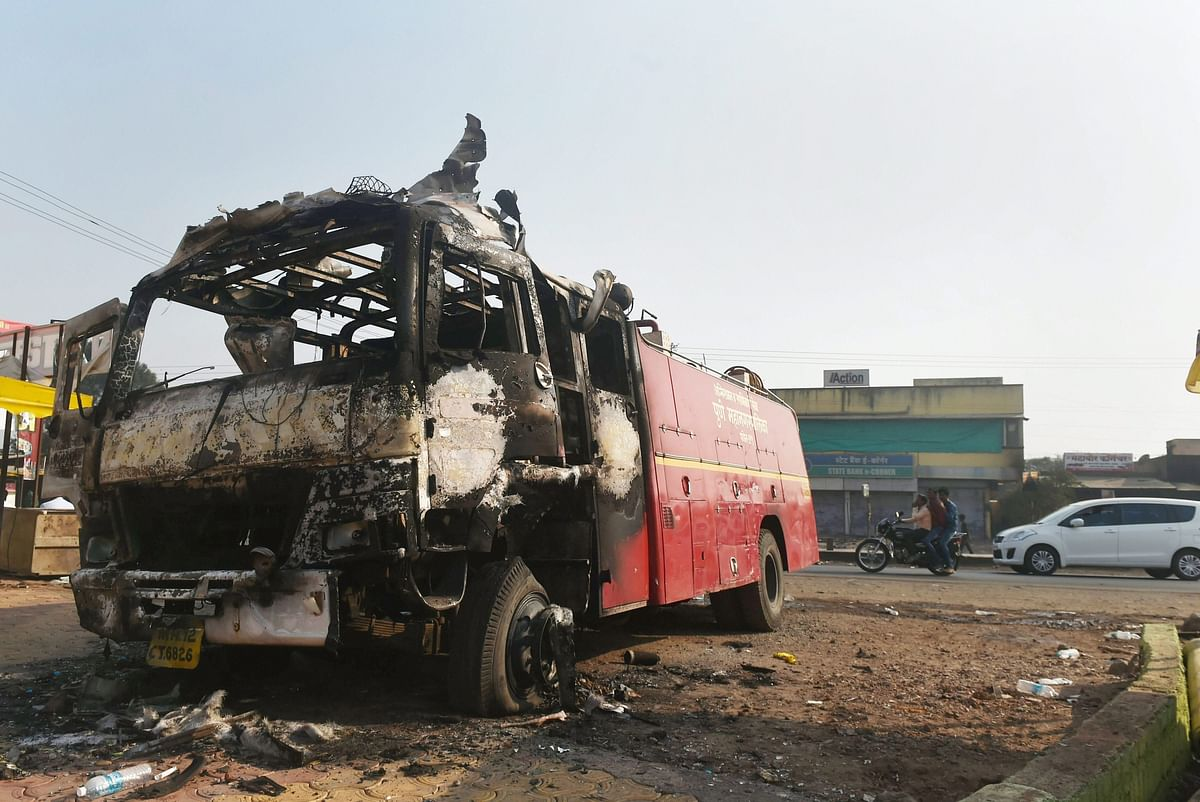 Charred remains of a firefighting vehicle following the violence during celebrations of 200th anniversary of the Battle of Bhima Koregaon, near Pune on Tuesday.
