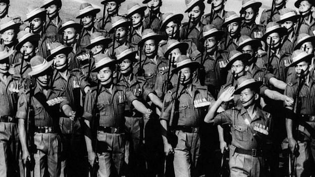 Army personnel march past Dr Prasad at the Irwin Amphitheater in 1950.
