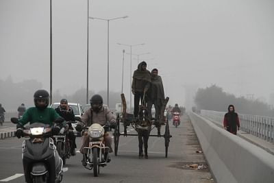 Commuters during a chilly winter morning in Jammu. (File Photo: IANS)