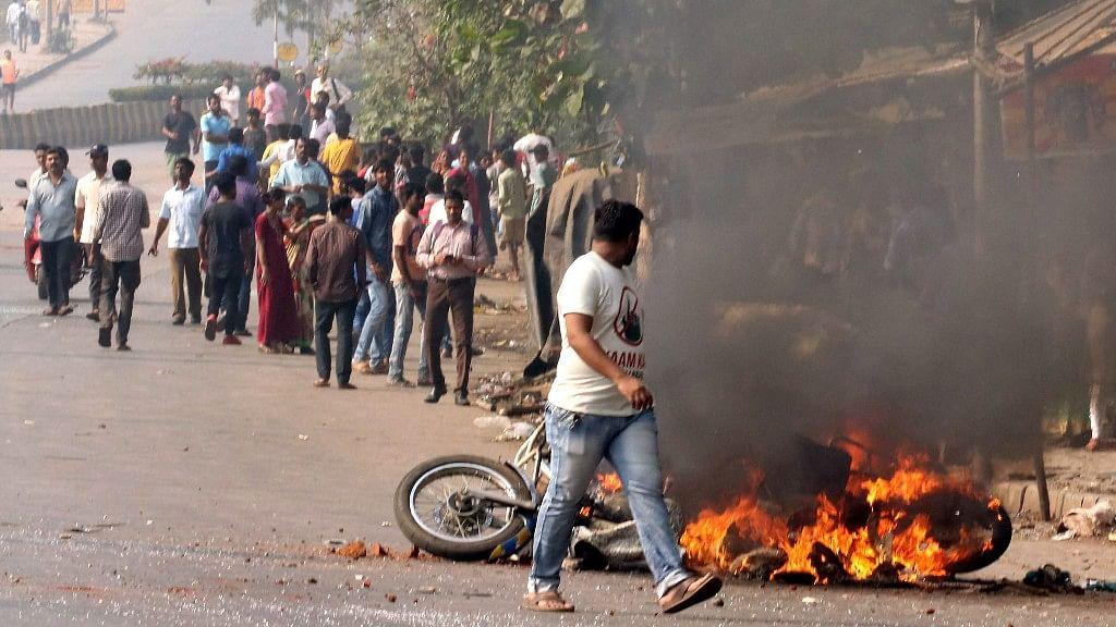 A bike set ablaze by protesters in Vikhroli, Mumbai, on 3 January 2018 during the protest over Bhima Koregaon violence.