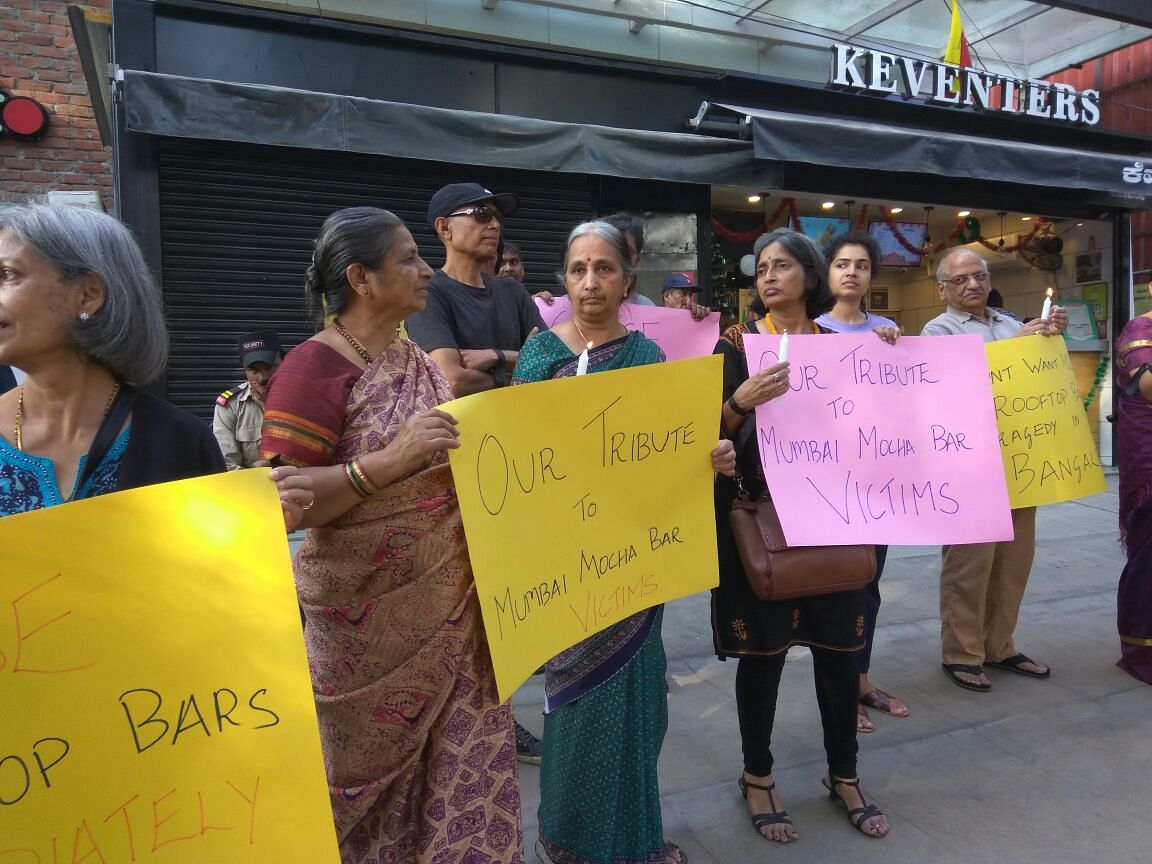 Members of I Change Indiranagar protest against high-rise buildings violating rules.