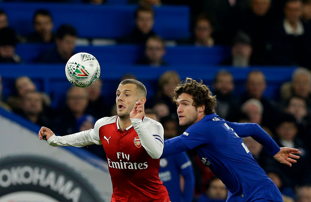 Arsenal's Jack Wilshere (left) challenges for the ball with Chelsea's Marcos Alonso.