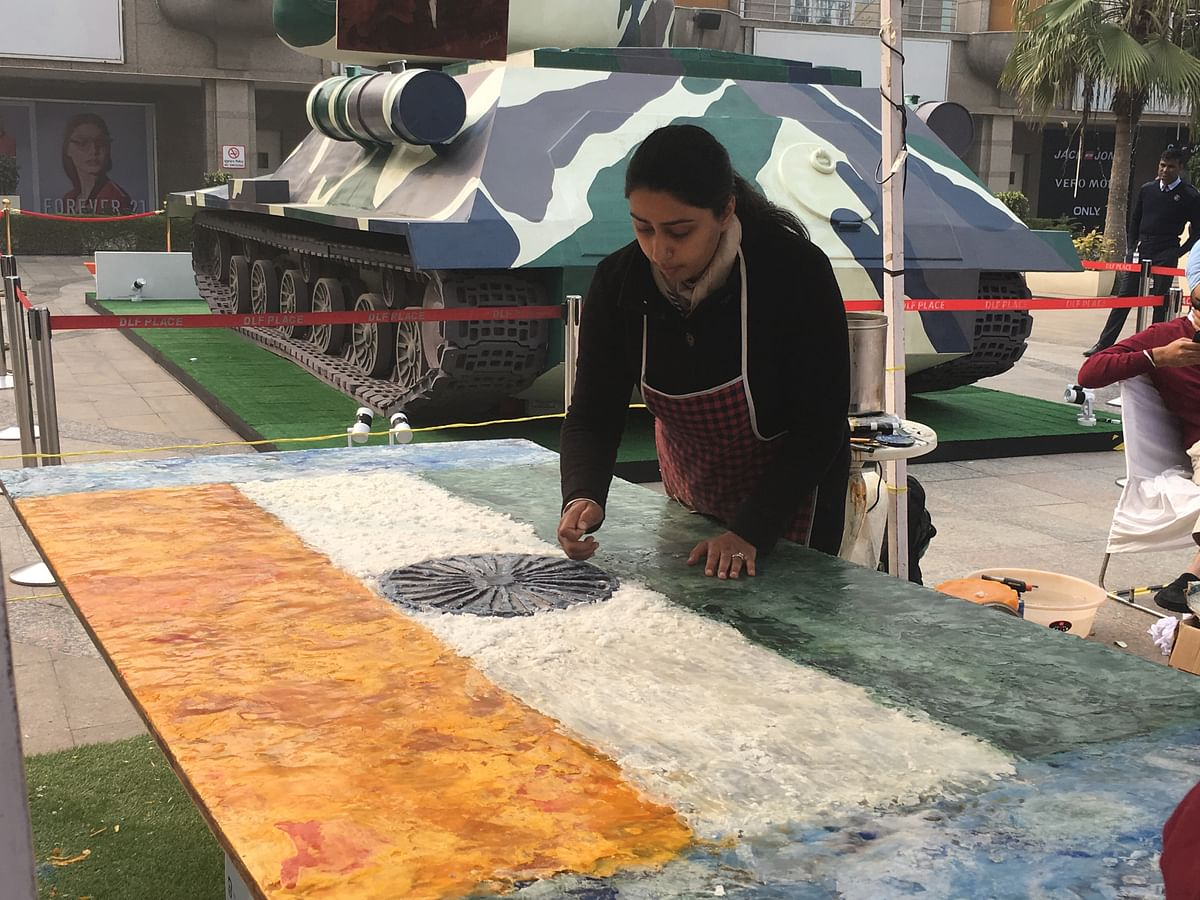 Harshish Brar giving finishing touches to the national flag she painted for the event.