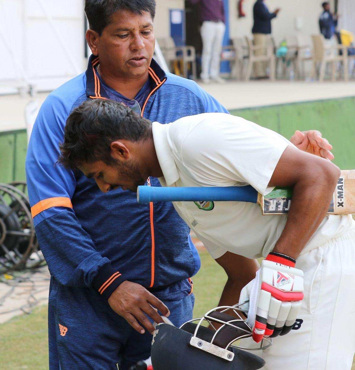 Akshay Wadkar of Vidarbha celebrates his century with coach Pandit on the third day of Ranji Trophy Final between Vidarbha and Delhi in Indore on Dec 31, 2017.