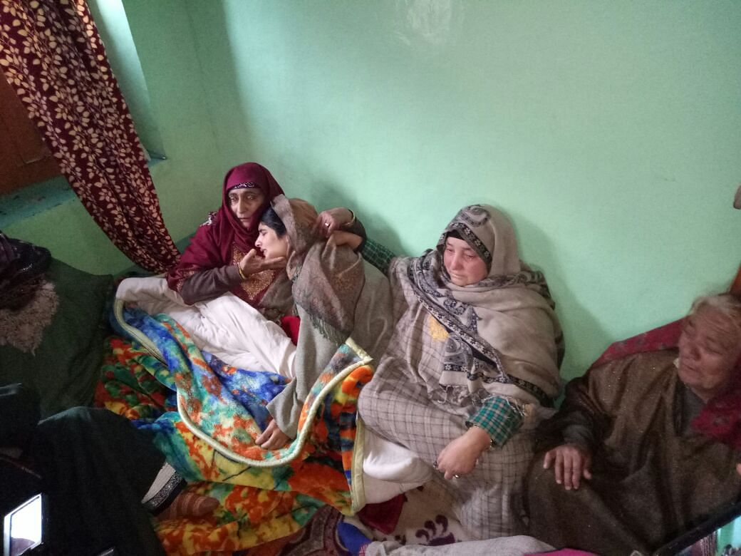 Mannan Wani's sister (second from left) mourning the news of her brother joining the Hizbul Mujahidden group.
