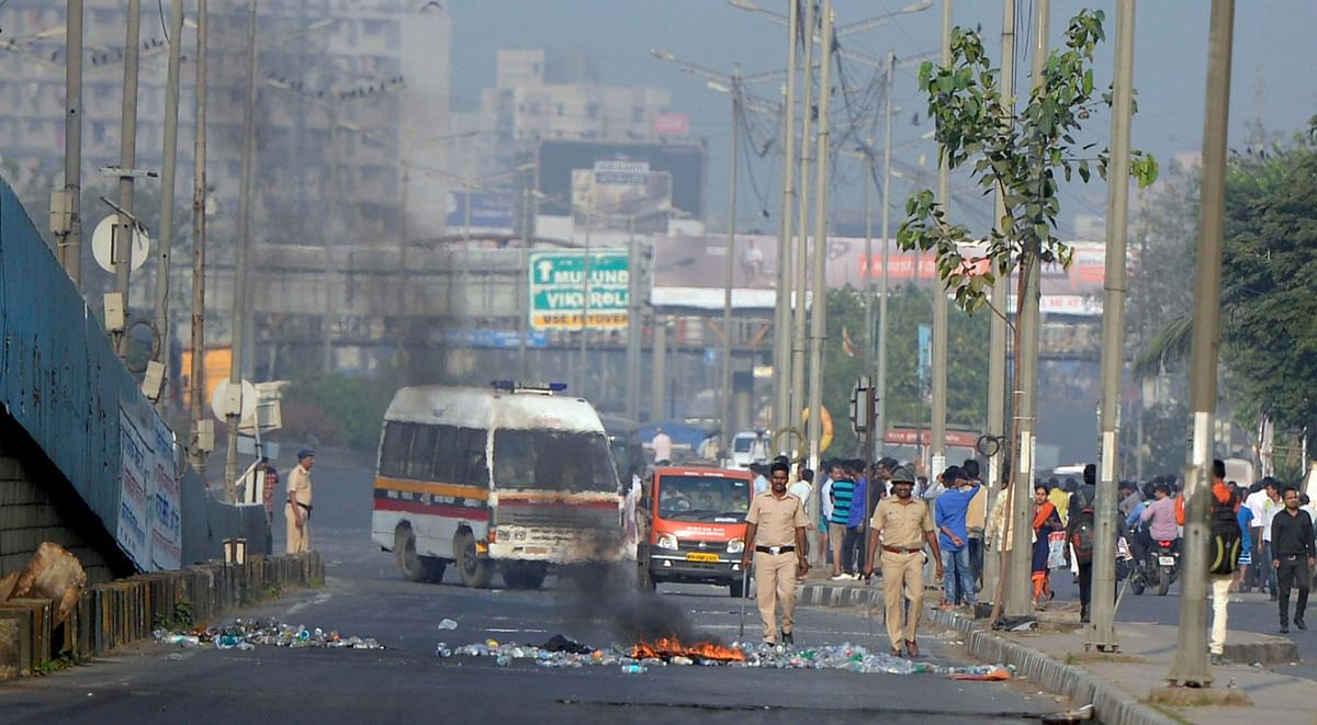 Policemen in Mumbai  try to control the situation after a violent protest by Dalits over the Bhima Koregaon unrest.
