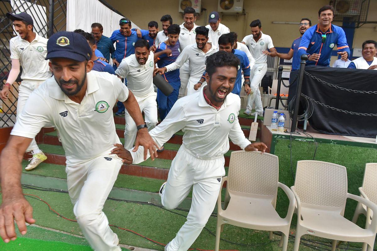 Skipper Faiz Fazal celebrates with teammates after Vidarbha clinch their maiden Ranji Trophy on 1 January 2018.
