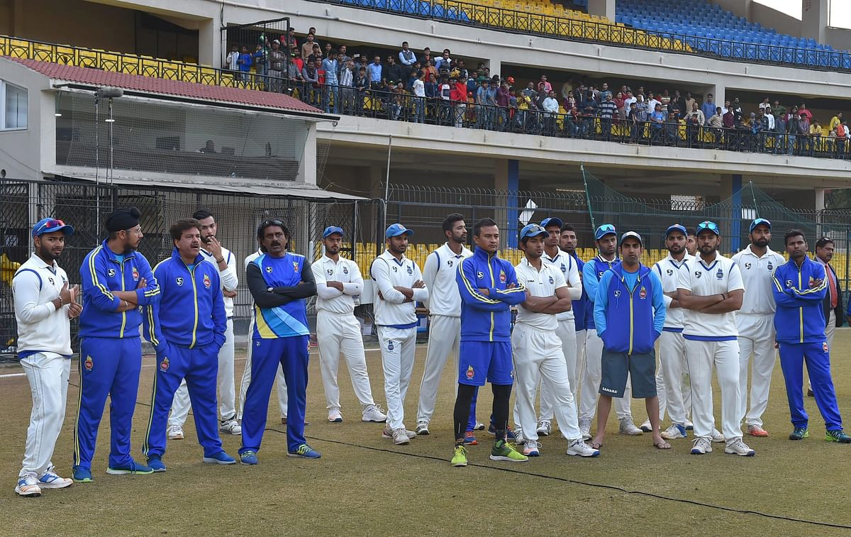 Delhi players during the presentation ceremony of the Ranji Trophy final cricket match against Delhi, in Indore on Monday.