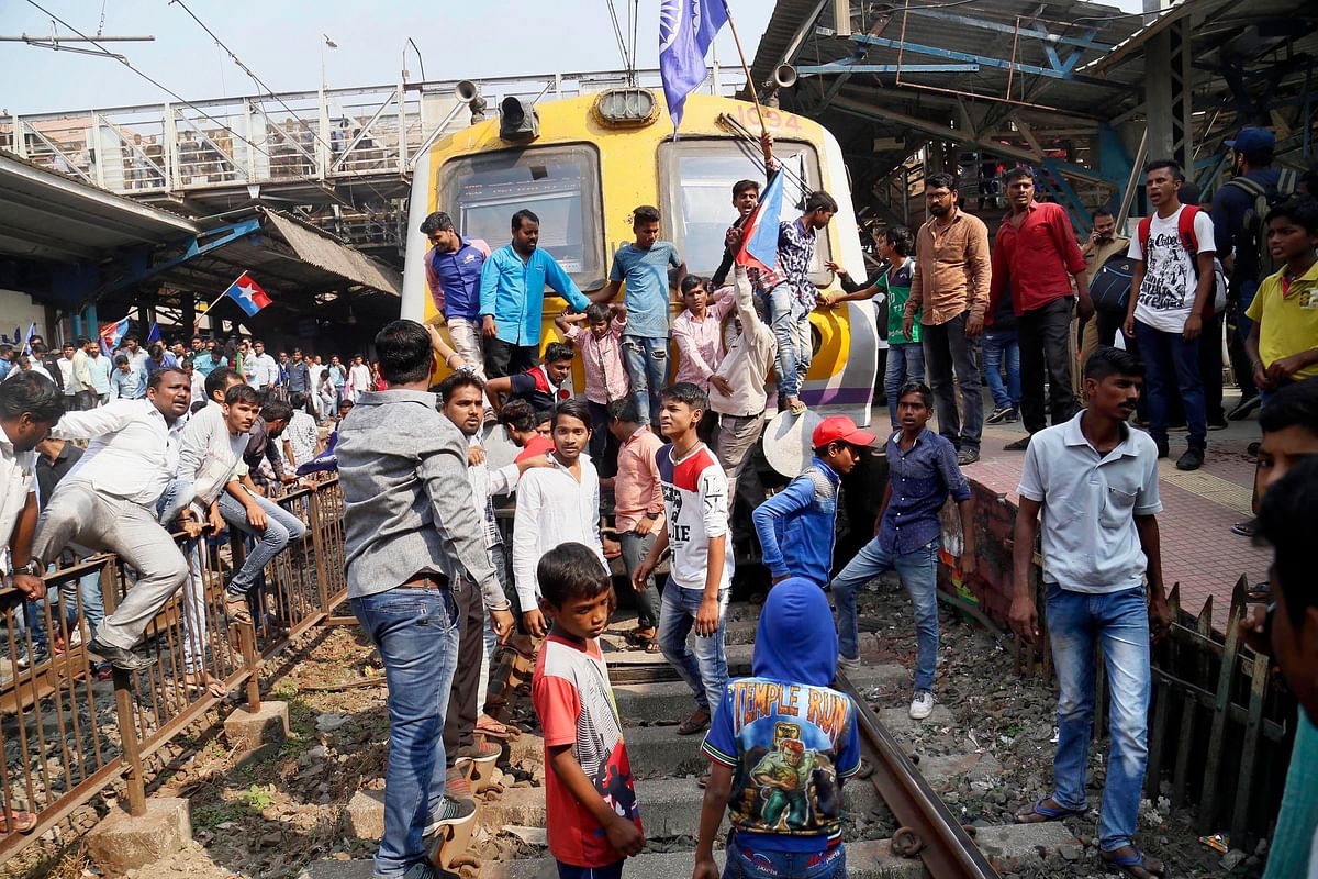 Dalit groups protesting at Thane railway station during the Maharashtra Bandh on Wednesday following clashes between two groups in Bhima Koregaon near Pune.