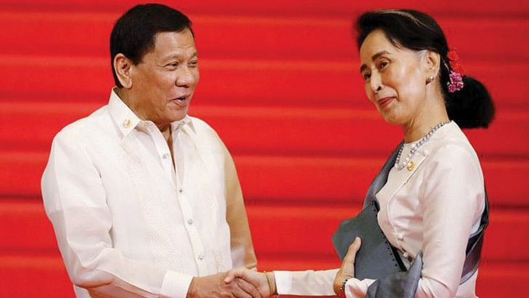 A file photo shows Philippines' Duterte greeting Myanmar State Counsellor Aung San Suu Kyi before the start of the 30th Asean Summit in Manila in April.