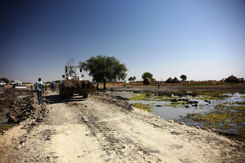 The UN Peacekeeping Mission engineers carried white soil from South Sudan's Malakal to the collapsed bridge near Akoka.