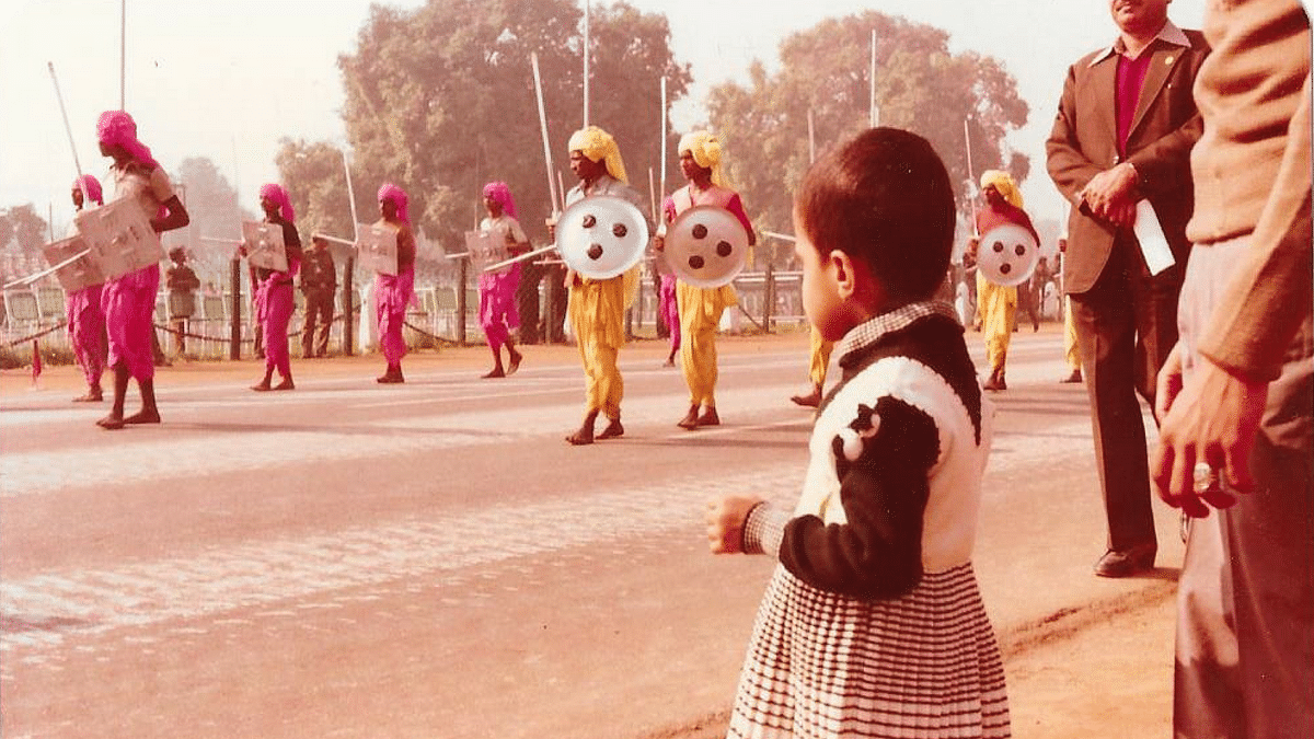 A young member of the family taking a closer look at one of the performances during the parade