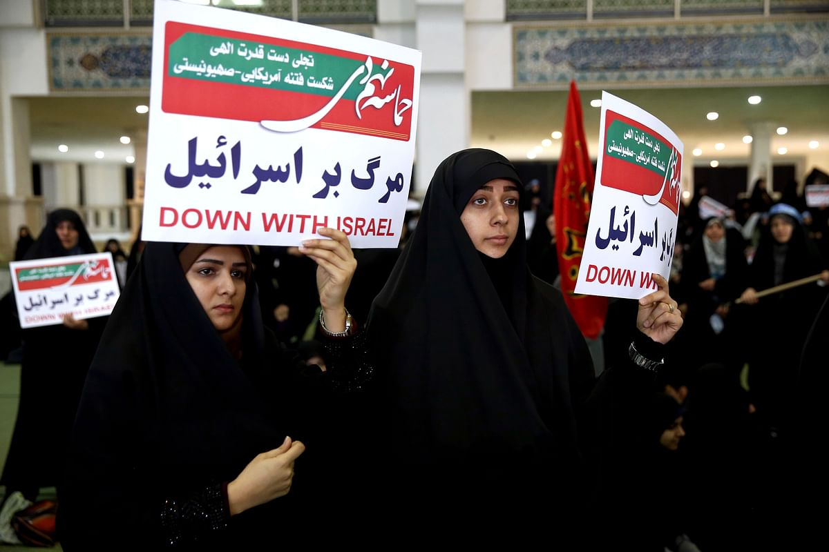 Iranian protesters hold anti-Israeli placards at a rally in Tehran, Iran on Saturday, 30 December.