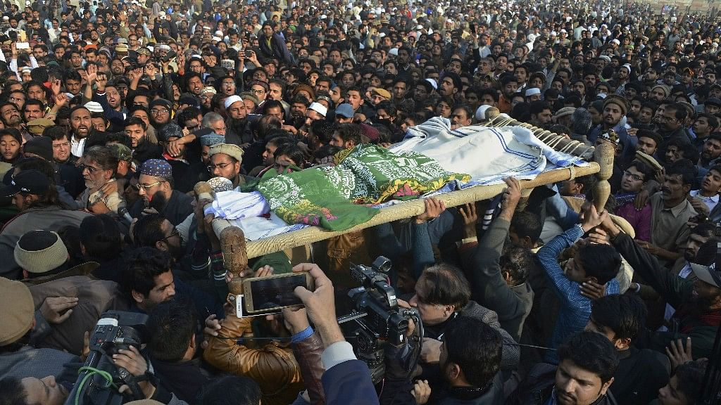 People attend a funeral of a Pakistani girl who was raped and killed, in Kasur, Pakistan, on 10 January.