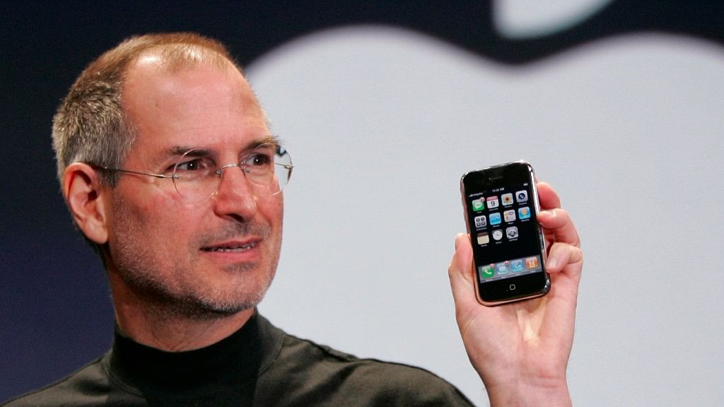 Steve Jobs with the first iPhone on 9 January 2007.