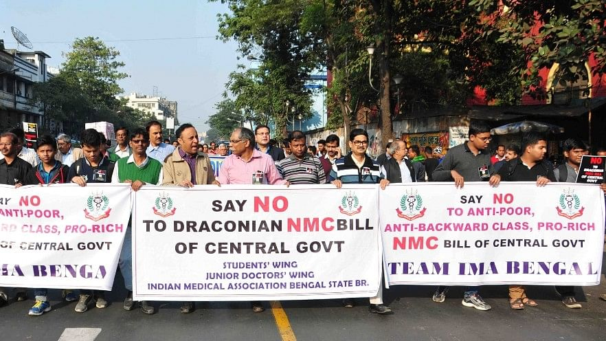 Doctors and medical students stage a protest against the National Medical Commission (NMC) Bill that was tabled in Parliament on Friday.
