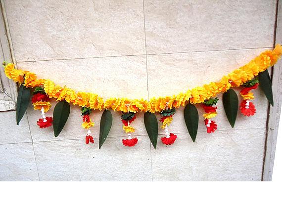 Door decoration of mango fronts and flower garlands.