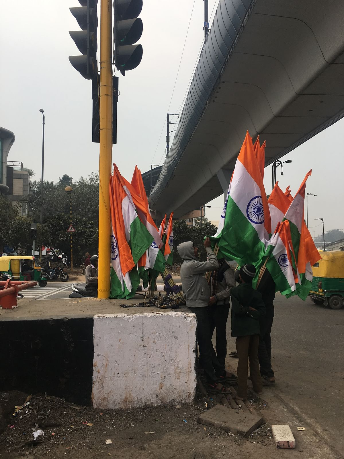 Scores of tricolours is a common sight near signals before Republic Day.
