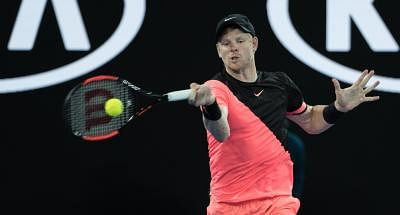 MELBOURNE, Jan. 25, 2018 (Xinhua) -- Kyle Edmund of Britain hits a return during the men