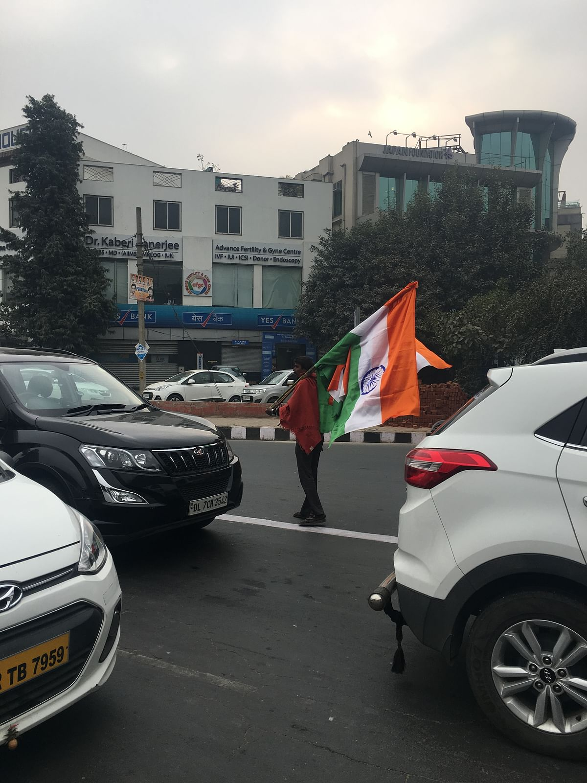 Kailash walks through the streets, selling Indian flags.