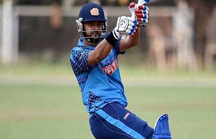 Suresh Raina plays a pull shot.
