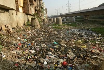 Before the sanitation drive, the place was a stinking mess, with open defecation, dumped garbage and stray pigs (Photo credit - Aga Khan Trust for Culture).