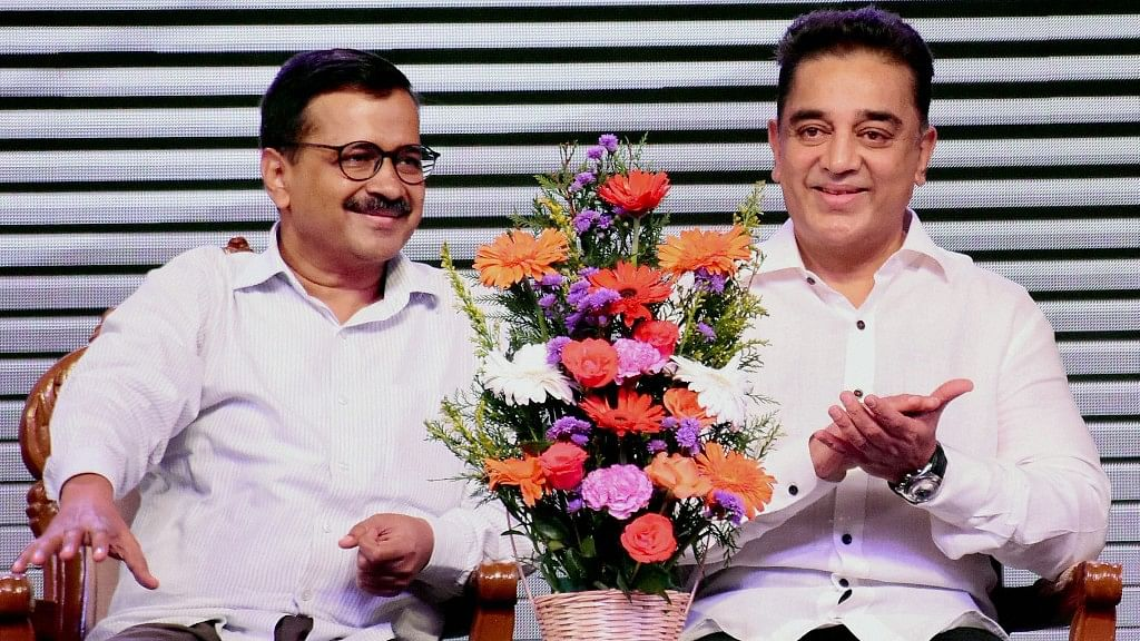 Kamal Haasan with Delhi Chief Minister Arvind Kejriwal during the launch of political party 'Makkal Needhi Maiam' in Madurai on 21 February.