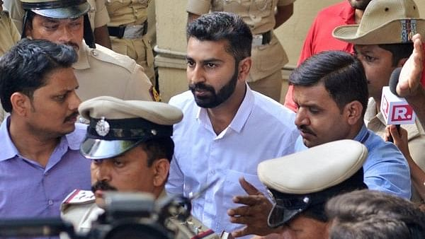 Son of MLA NA Haris and Youth Congress general secretary Mohammed Haris Nalapadbeing taken away by the police for allegedly assaulting a person in Bengaluru on Monday, 26 February.