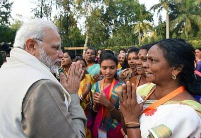 New Delhi: Prime Minister Narendra Modi interacts with the beneficiaries of the Pradhan Mantri Ujjwala Yojana in New Delhi on Feb 13, 2018. (Photo: IANS/PIB)