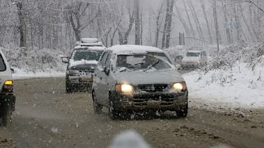 A file image of vehicles moving through the snow-covered streets in Srinagar. Image used for representational purpose only.