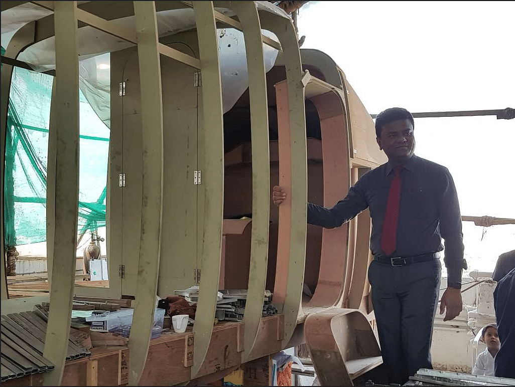Amol Yadav standing near his prototype-19 seater plane on his rooftop in Charkop, Mumbai.