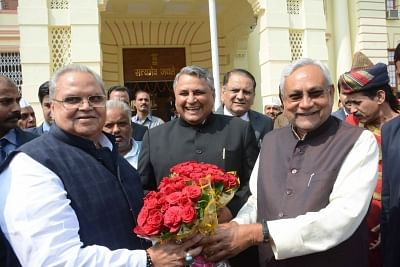 Patna: Bihar Governor Satya Pal Malik being received by Chief Minister Nitish Kumar on his arrival at the state assembly in Patna on Feb 26, 2018. (Photo: IANS)