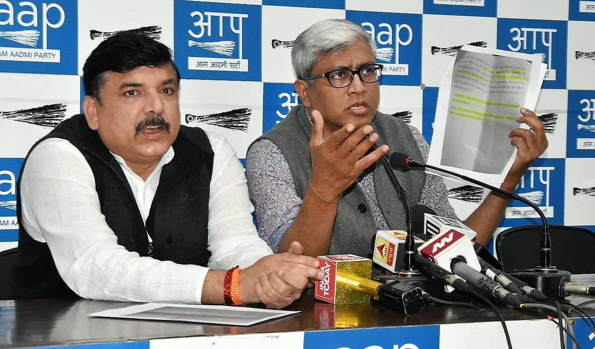 AAP Rajya Sabha MP Sanjay Singh with  spokesperson Ashutosh address a press conference over the detainment of two AAP MLAs, in New Delhi on Thursday 22 February.