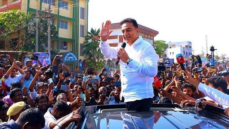 Kamal Haasan addresses a crowd gathered to see him.