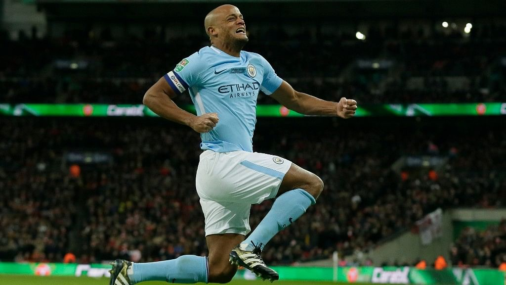 Manchester City's Vincent Kompany celebrates after he scores the second goal of the game during the English League Cup Final against Arsenal on Sunday.