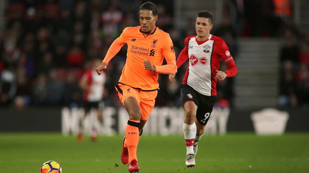 Liverpool's Virgil van Dijk (left) and Southampton's Guido Carrillo battle for the ball during their at St Mary's Stadium on Sunday.