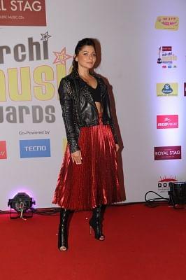 """Mumbai: Singer Kanika Kapoor at the red carpet of """"10th Mirchi Music Awards"""" in Mumbai on Jan 28, 2018. (Photo: IANS)"""
