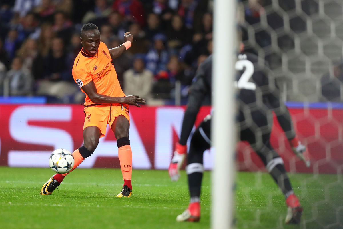 Liverpool's Sadio Mane scores the opening goal  during the Champions League round of sixteen first leg match between FC Porto and Liverpool FC at the Dragao stadium in Porto.