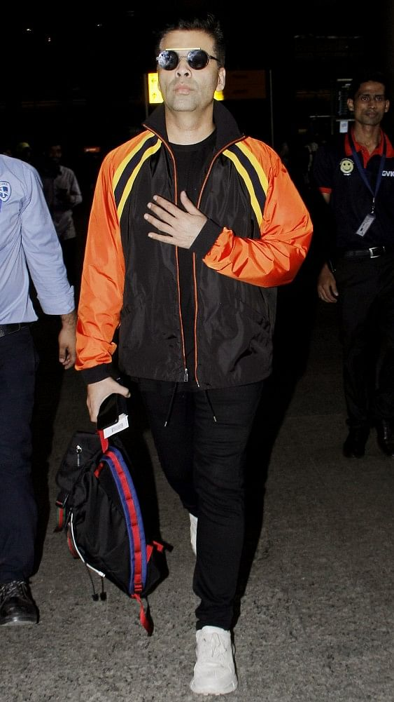 Karan Johar all black with a pinch of orange and yellow is the way to go.