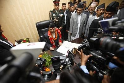 KATHMANDU, Oct. 13, 2015 (Xinhua) -- Newly appointed Prime Minister Khadga Prashad Oli (1st L) talks with the media when he assumes his post at his office at Singha Durbar, Kathmandu, Nepal, Oct. 12, 2015. Chairman of the Communist Party of Nepal (Unified Marxist-Leninist) (CPN-UML) Khadga Prashad Oli, also known as KP Oli was elected as the 38th Prime Minister of Nepal on Oct. 11. (Xinhua/Pratap Thapa)