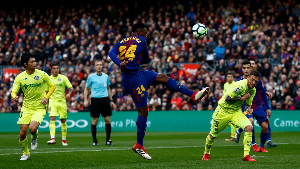 Barcelona's Yerry Mina (centre) kicks the ball during the Spanish La Liga match between Barcelona and Getafe at Camp Nou.