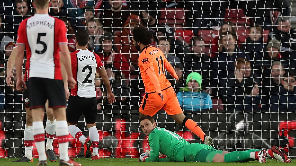 Liverpool's Mohamed Salah scores against Southampton  at St Mary's Stadium in Southampton.