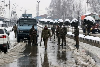 Srinagar: CRPF personnel during search operations in Srinagar on Feb 12, 2018. An alert sentry at a Central Reserve Police Force (CRPF) camp here in Jammu and Kashmir on Monday averted a possible militant attack by firing at approaching militants forcing them to flee. According to sources, Two militants carrying bags and AK-47 rifles were seen by the sentry approaching the camp of the 23 battalion of CRPF in Karan Nagar area around 4.30 a.m. Searches are on around the camp periphery. (Photo: IAN