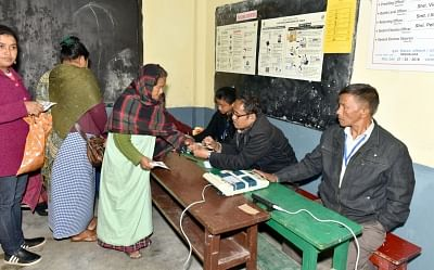 Shillong: A polling official administers phosphoric ink to a voter at a polling booth during Meghalaya Assembly elections in Shillong on Feb 27, 2018. A total of 18,09,818 electorates, including 9,13,702 women and 89,405 first-time voters are eligible to exercise their franchise to decide the fate of 361 candidates, including 31 women and many independents. (Photo: IANS/PIB)