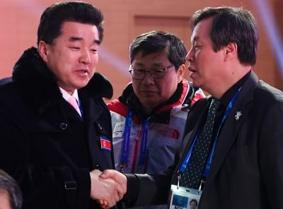 Pyeongchang: South Korean Sports Minister Do Jong-hwan (R) shakes hands with his North Korean counterpart Kim Il-guk during a reception to mark the closing of the PyeongChang Winter Olympics in Pyeongchang, east of Seoul, on Feb. 25, 2018. (Yonhap/IANS)